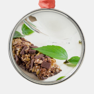 Chocolate bar with a cereal and milk for breakfast Silver-Colored round decoration