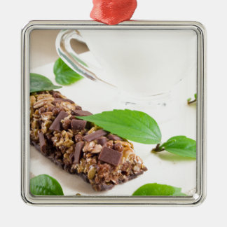 Chocolate bar with a cereal and milk for breakfast Silver-Colored square decoration