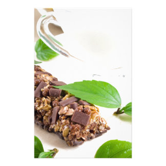 Chocolate bar with a cereal and milk for breakfast stationery