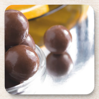 Chocolate candies in a small glass bowl close-up coaster
