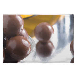Chocolate candies in a small glass bowl close-up place mats