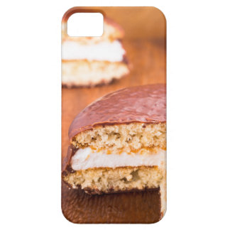 Chocolate cookies with milk souffle on a brown iPhone 5 covers