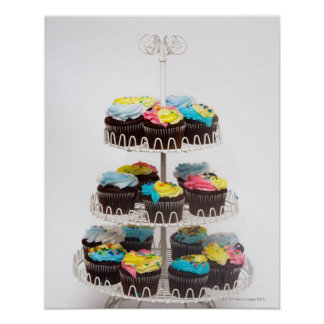 Chocolate cupcakes on a cake stand poster