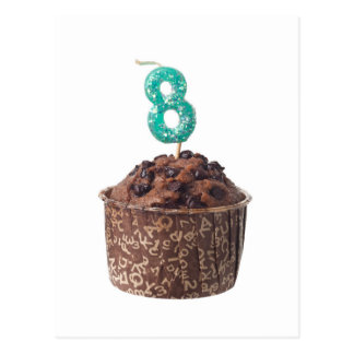 Chocolate muffin with candle for eight year old postcard