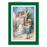 Christmas Angel with Girl Trimming Tree Card