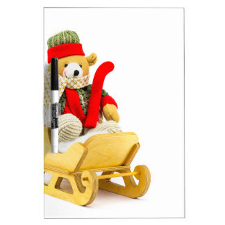 Christmas bear in wooden sleigh on white dry erase board