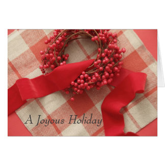 Christmas berries and wreath on plaid greeting card
