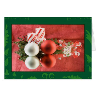 Christmas candle and red and white ornaments greeting card