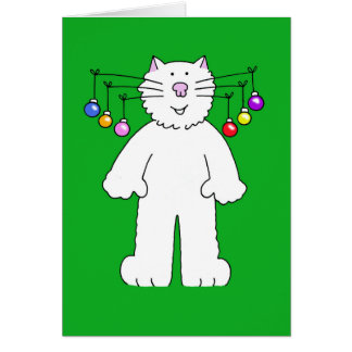 Christmas cat, baubles hanging from it's whiskers. card
