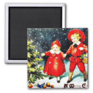 Christmas greeting with a boy and a girl looking a fridge magnet