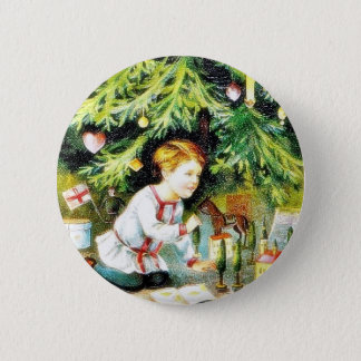 Christmas greeting with a boy playing under the de 6 cm round badge