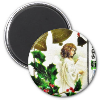 Christmas greeting with an angel ready a paper and refrigerator magnets