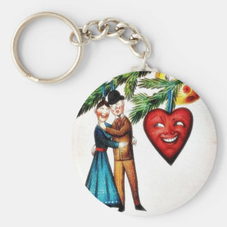 Christmas greeting with couples dancing key chains