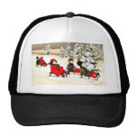Christmas greeting with kids snow slading trucker hat