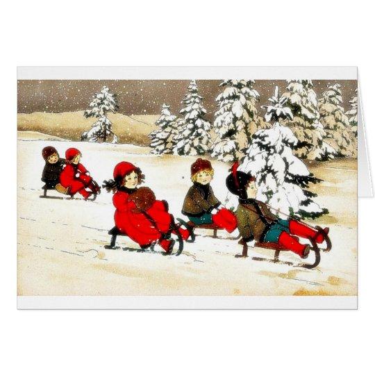 Christmas greeting with kids snow slading card