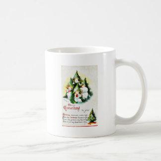 Christmas greeting with kids wearing christmas tre coffee mugs