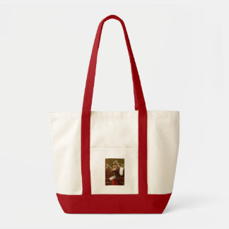Christmas kitten sleepiing on mantle Tote bag