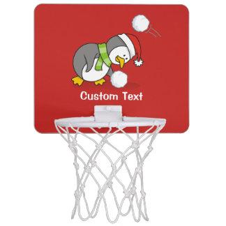 Christmas penguin getting a snow ball mini basketball hoop