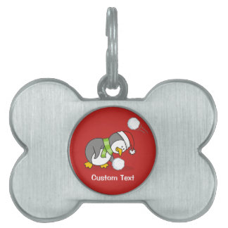 Christmas penguin getting a snow ball pet ID tag