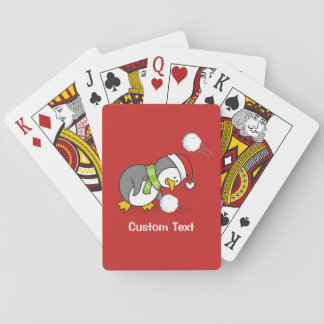 Christmas penguin getting a snow ball playing cards