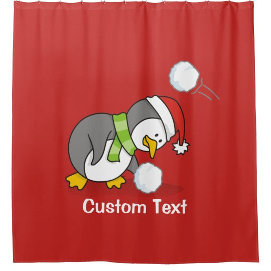 Christmas penguin getting a snow ball shower curtain