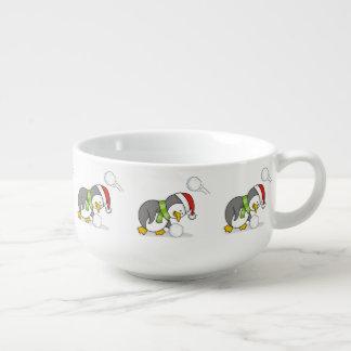 Christmas penguin getting a snow ball soup mug