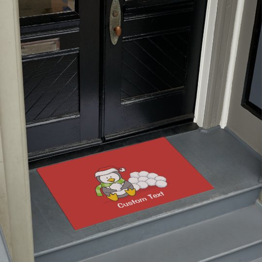 Christmas penguin sitting with snow balls doormat