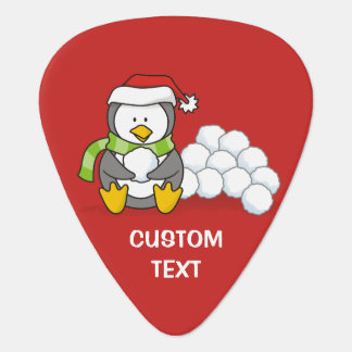 Christmas penguin sitting with snow balls plectrum
