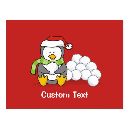 Christmas penguin sitting with snow balls postcard