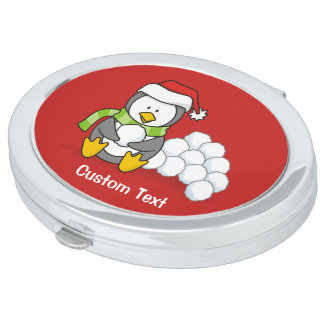 Christmas penguin sitting with snow balls vanity mirror