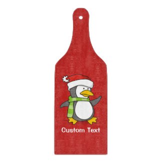 Christmas penguin walking on snow cutting board