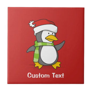 Christmas penguin walking on snow tile