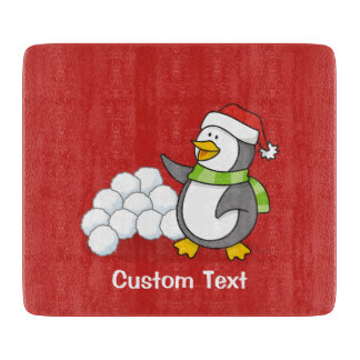 Christmas penguin with snow balls waving cutting board
