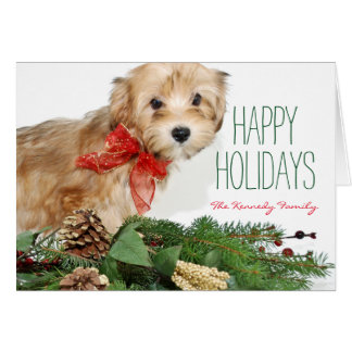 Christmas puppy with red bow greeting card