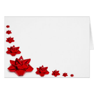 Christmas red bows on white greeting card