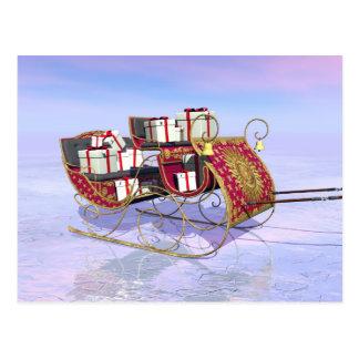 Christmas sleigh carrying gifts postcard