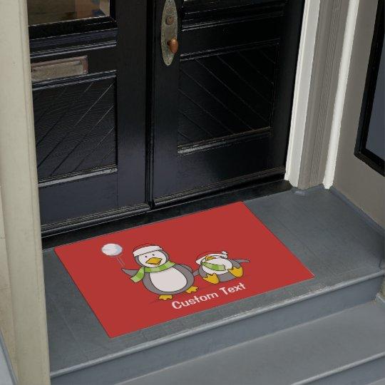 Christmas Snowballing penguins Doormat