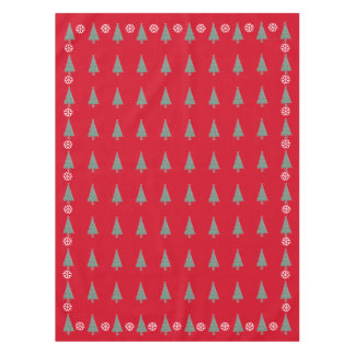 Christmas tree and decorations and red bows tablecloth