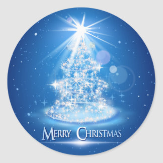 Christmas tree and light over blue background round sticker