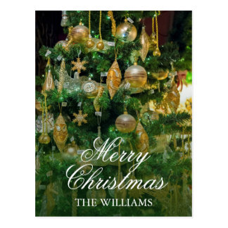Christmas tree with gold multi-shaped ornaments. postcard