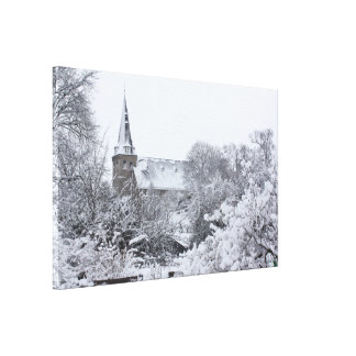 church in snow stretched canvas prints