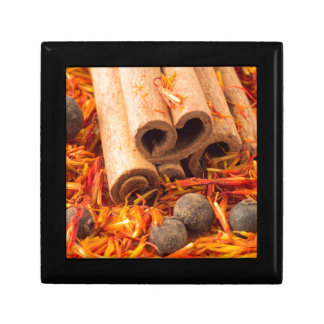 Cinnamon, peppercorn and saffron close-up small square gift box