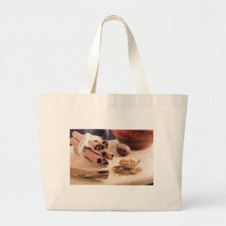 Cinnamon sticks and powder large tote bag