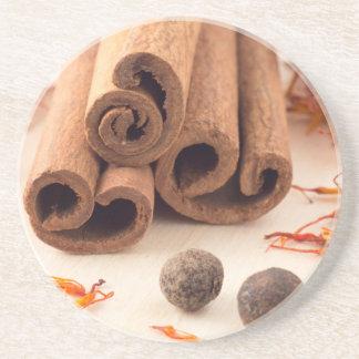 Cinnamon sticks, aromatic saffron and pimento coaster