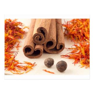 Cinnamon sticks, aromatic saffron and pimento postcard