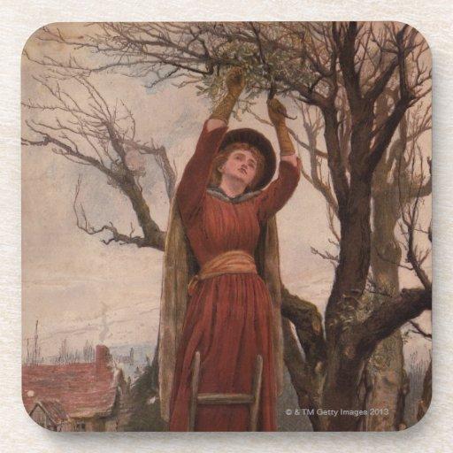 Circa 1820: A young woman cuts mistletoe Coasters