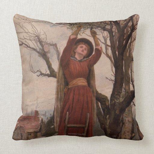 Circa 1820: A young woman cuts mistletoe Throw Pillows