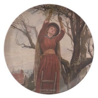 Circa 1820: A young woman cuts mistletoe Dinner Plates