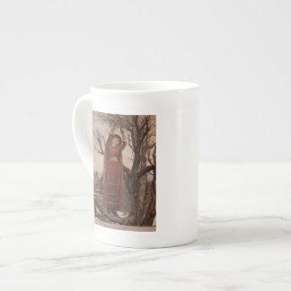 Circa 1820: A young woman cuts mistletoe Porcelain Mug
