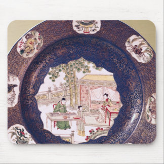 Circular dish with a musical scene mouse pad